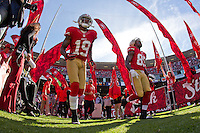 11 November 2012: Wide receiver (19) Ted Ginn, Jr., and tight end (85) Vernon Davis 49ers run onto the field during player introductions before the 49ers and the St. Louis Rams play to a 24-24 tie between in an NFL football game at Candlestick Park in San Francisco, CA.