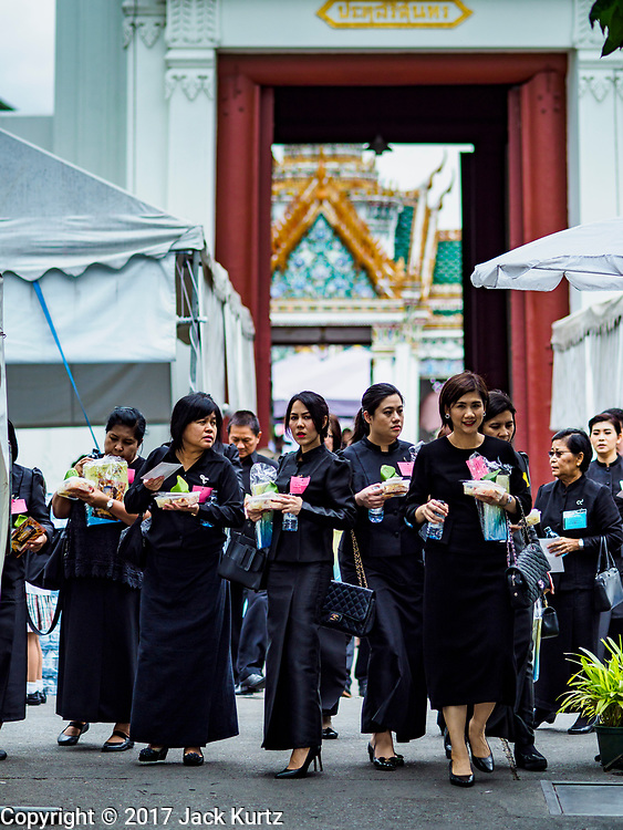19 JULY 2017 - BANGKOK, THAILAND:    People leave the Grand Palace in Bangkok after paying respects for Bhumibol Adulyadej, the Late King of Thailand. The King, also known as Rama IX, was the ninth of the King of the Chakri Dynasty and died after a long illness on October 13, 2016. He will be cremated on October 26, 2017.            PHOTO BY JACK KURTZ