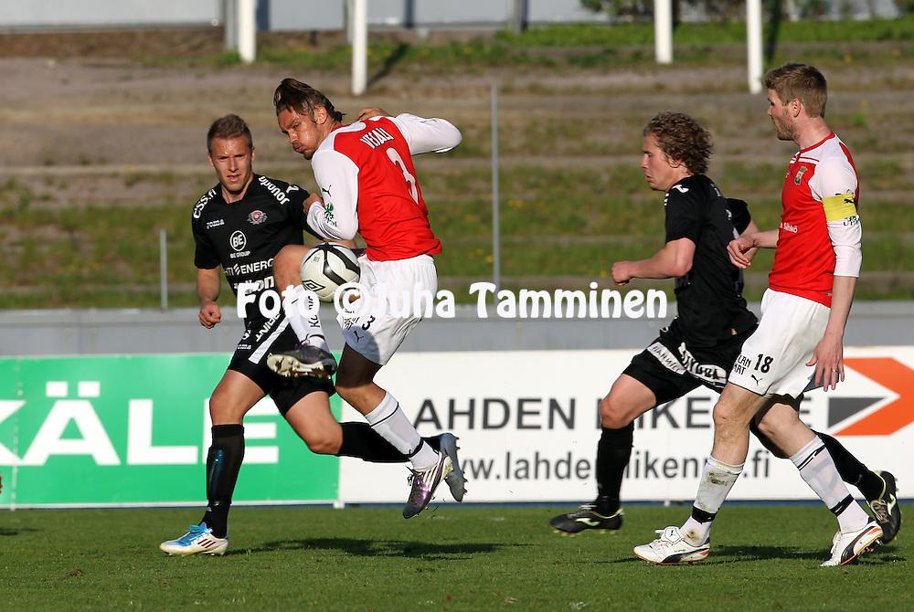 24.5.2012, Hiihtostadion, Lahti..Veikkausliiga 2012..FC Lahti - Myllykosken Pallo-47..Tommi Vesala & Tuomas Aho (MYPA) v Ville Taulo & Jaakko Lepola (Lahti).