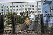 Gate, fence and coat of arms in front of Batumi Shota Rustaveli State University, Batumi, Georgia