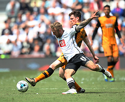 Johnny Russell of Derby County (L) and Andrew Robertson of Hull City in action - Mandatory by-line: Jack Phillips/JMP - 14/05/2016 - FOOTBALL - iPro Stadium - Derby, England - Derby County v Hull City - Sky Bet Championship Play-Off Semi-Final First-Leg