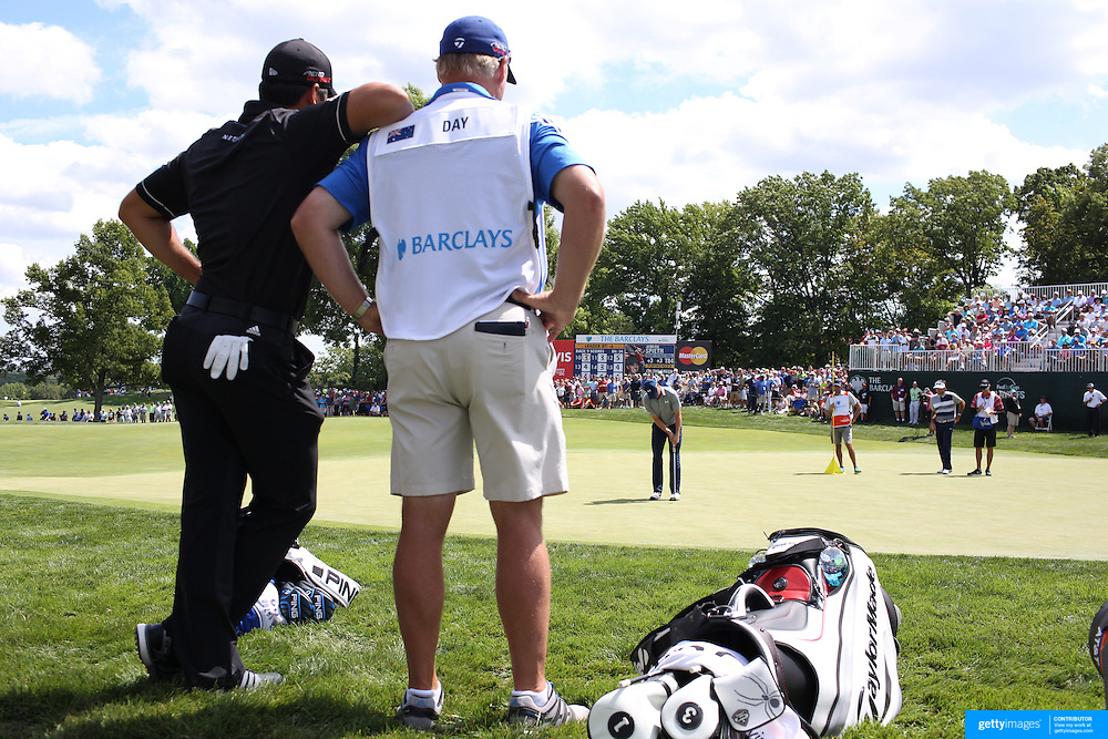 Jason Day, Australia, with Caddie Colin Swatton watch Jordan Spieth, USA, putting during The Barclays Golf Tournament at The Plainfield Country Club, Edison, New Jersey, USA. 27th August 2015. Photo Tim Clayton