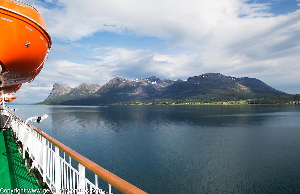 Steep mountains of Grytoya island, Troms county, northern Norway from Hurtigruten ferry ship