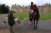 Fox Hunting.Hampshire, England, February 9th, 2005 - Vale of Aylesbury with Garth and south hunt, joint master directing one of foot followers on the meet at Stratfield Saye House, Hampshire