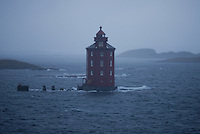 Kjeungskjær Lighthouse in Norway on a Cold Windy Rainy Winter Day from the Deck of the Hurtigruten MV Nordkapp. Image taken with a Nikon D800 and 180 mm f/2.8D lens (ISO 400, 180 mm, f/2.8, 1/320 sec).