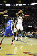 Jan 31, 2010; Cleveland, OH, USA; Cleveland Cavaliers forward LeBron James (23) shoots over Los Angeles Clippers guard Rasual Butler (45) during the first quarter at Quicken Loans Arena. Mandatory Credit: Jason Miller-US PRESSWIRE