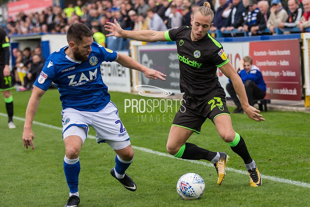 Forest Green Rovers Joseph Mills(23) is challenged by Macclesfield Town's Jared Hodgkiss(2) during the EFL Sky Bet League 2 match between Macclesfield Town and Forest Green Rovers at Moss Rose, Macclesfield, United Kingdom on 29 September 2018.