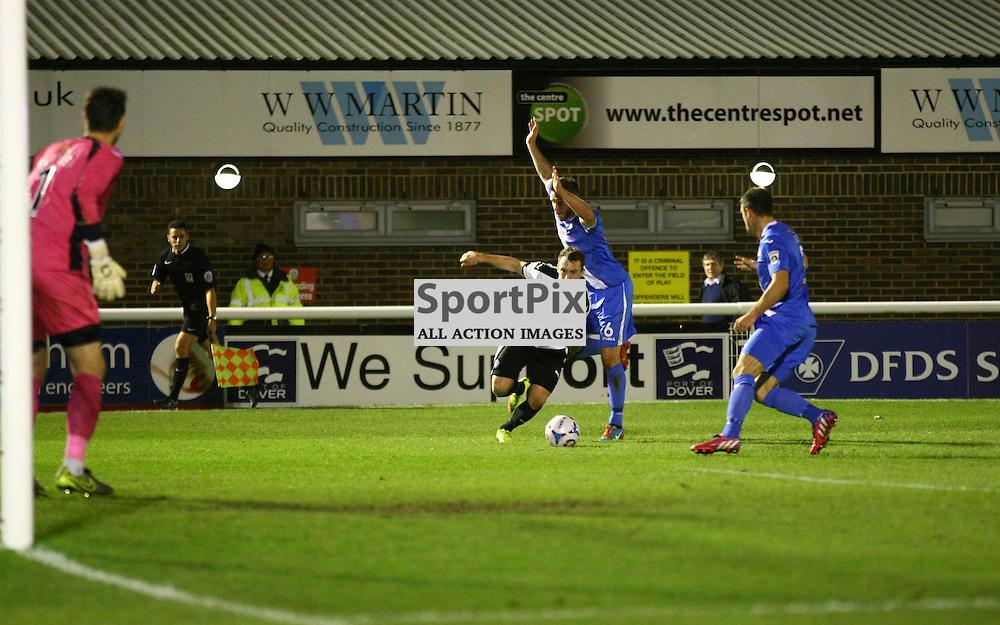 Dover's striker Ricky Miller (9) passes Eastleigh's defender Paul Reid (6) heading for the goal. Dover Athletic v Eastleigh. Vanarama National League. 10  November 2015. (c) Matt Bristow | SportPix.org.uk