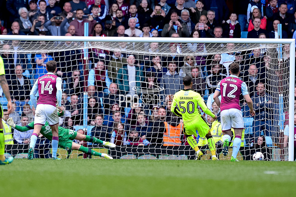 Reading striker (on loan from Bournemouth) Lewis Grabban (50) scores a goal from the penalty spot  1-3 during the EFL Sky Bet Championship match between Aston Villa and Reading at Villa Park, Birmingham, England on 15 April 2017. Photo by Dennis Goodwin.