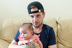Proud dad Darren Arnold with little kia Rose. Kia Neale, 20, gave birth to her baby Harriet Rose just 48 hours after discovering that she was 22 weeks pregnant. Little Harriet Rose was born 18 weeks prematurely on the steps to the bathroom of their Whitechapel flat, delivered by her partner Darren Arnold, 23. Harriet Rose is two-year-old Harper's little sister. London, August 01 2019.
