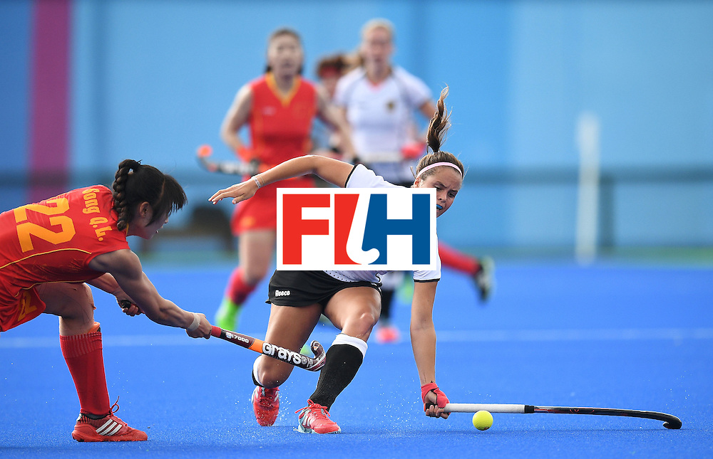 China's Song Qingling (L) tries to stop Germany's Cecile Pieper during the women's field hockey China vs Germany match of the Rio 2016 Olympics Games at the Olympic Hockey Centre in Rio de Janeiro on August, 7 2016. / AFP / MANAN VATSYAYANA        (Photo credit should read MANAN VATSYAYANA/AFP/Getty Images)