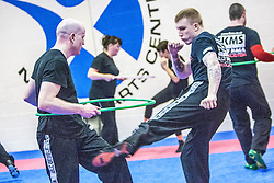 Kicking under the hoop, Stef Noij, KMG Instructor from the Institute Krav Maga Netherlands, at the IKMS G Level Programme seminar today at the Scottish Martial Arts Centre, Alloa.