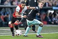 23-10-2016: Voetbal: Feyenoord v Ajax: Rotterdam<br /> <br /> (L-R) Feyenoord speler Bilal Basacikoglu, Ajax speler Daley Sinkgraven tijdens het Eredivsie duel tussen Feyenoord en Ajax op 23 oktober in stadion Feijenoord (de Kuip) tijdens speelronde 10<br /> <br /> Eredivisie - Seizoen 2016 / 2017<br /> <br /> Foto: Gertjan Kooij