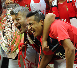 Arsenal's Santi Cazorla pours champagne over Arsenal's Jack Wilshere and Arsenal new signing, Alexis Sanchez - Photo mandatory by-line: Joe Meredith/JMP - Mobile: 07966 386802 10/08/2014 - SPORT - FOOTBALL - London - Wembley Stadium - Arsenal v Manchester City - FA Community Shield