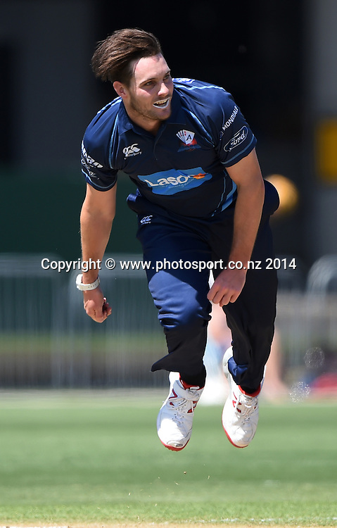 Auckland's Mitchell McClenaghan bowling during the Ford Trophy one day cricket match between Auckland Aces and Wellington Firebirds at the Eden Park Outer Oval, Auckland, New Zealand. Saturday 27 December 2014. Photo: Andrew Cornaga/www.Photosport.co.nzz