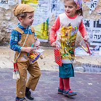 JERUSALEM - MARCH 13 : Ultra Orthodox children during Purim in Mea Shearim Jerusalem on March 13 2017 , Purim is a Jewish holiday celebrates the salvation of the jews from genocide in ancient Persia