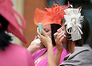 © Licensed to London News Pictures. 21/06/2012. Ascot, UK A woman corrects hear makeup. Ladies Day at Royal Ascot 21st June 2012. Royal Ascot has established itself as a national institution and the centrepiece of the British social calendar as well as being a stage for the best racehorses in the world.. Photo credit : Stephen Simpson/LNP