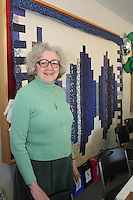 The Comer Children&rsquo;s Hospital Service League&rsquo;s annul Irish Coffee benefit and silent raffle was held this past Saturday at Augustana Lutheran Church located at 5500 S. Woodlawn.<br /> <br /> 0982 &ndash; Carol Bradford stands next to a quilt that she donated to be auctioned off.