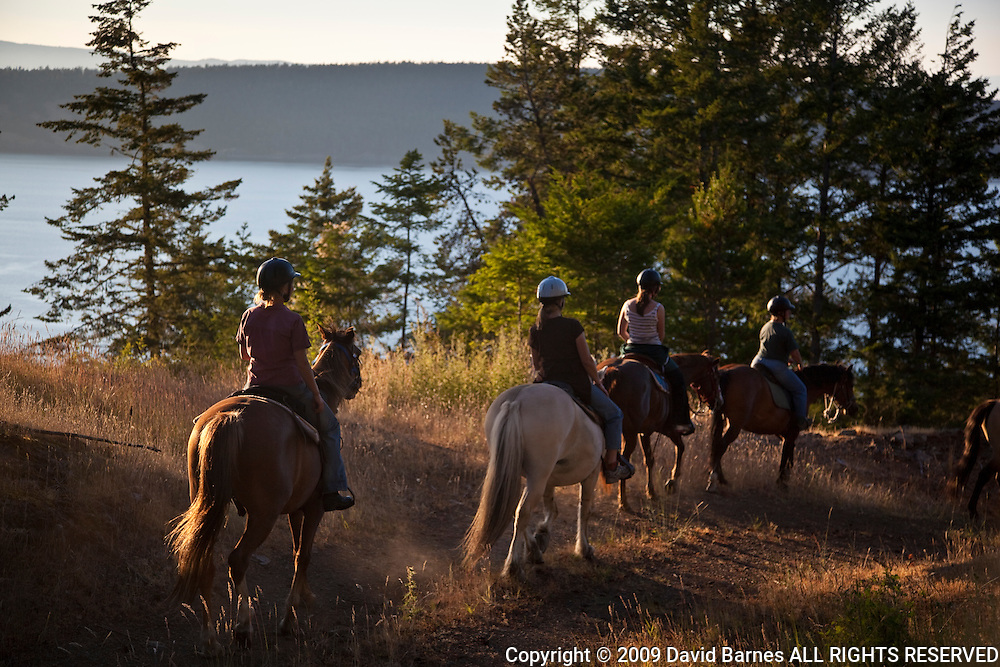 Woman horseback riding, Orcas Island, San Juan Islands, Washington, USA
