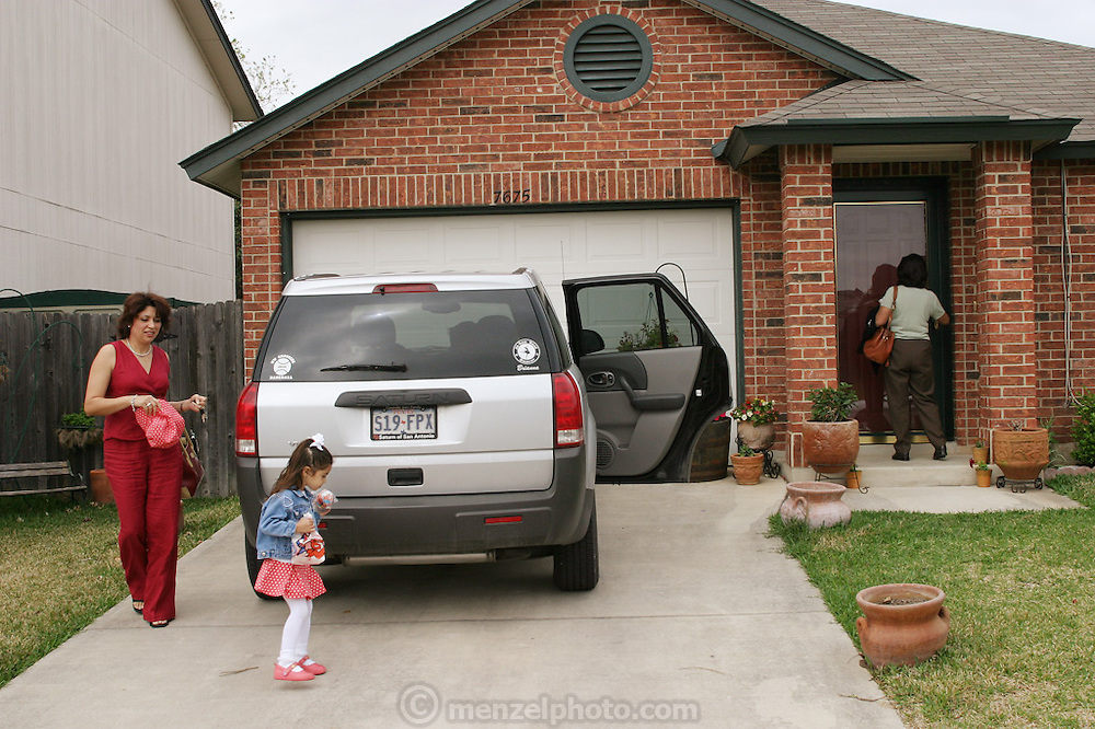 (MODEL RELEASED IMAGE). Diana Fernandez follows her daughter Brianna into their house in San Antonio, Texas, after the family has been to buy food from Whataburger. Already at the door is Diana's mother Alejandrina Cepeda. (Supporting image from the project Hungry Planet: What the World Eats.)