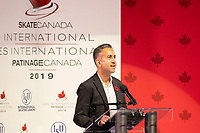 KELOWNA, BC - OCTOBER 25: City of Kelowna Mayor, Colin Basran, stands at the podium and welcomes visitors to Kelowna during the opening ceremonies of Skate Canada International at Prospera Place on October 25, 2019 in Kelowna, Canada. (Photo by Marissa Baecker/Shoot the Breeze)