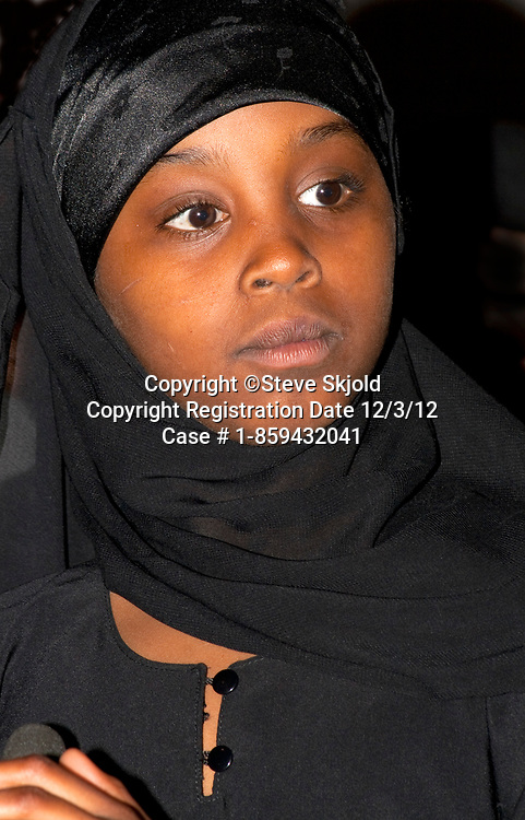 Black Muslim American student age 10 wearing a hijab sings in school choir. Horace Mann School. St Paul Minnesota MN USA