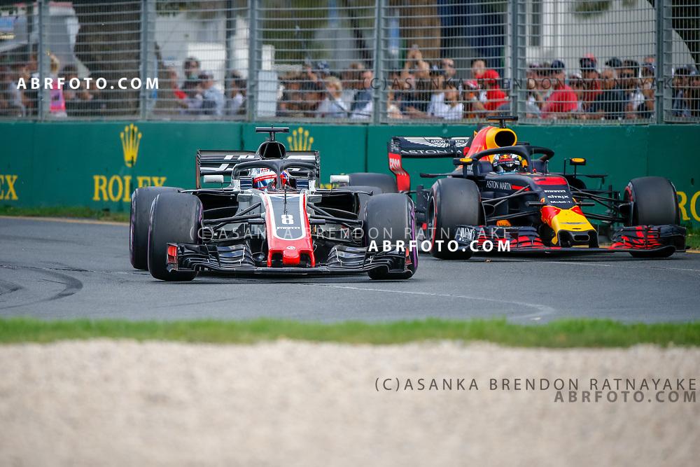 Haas driver Romain Grosjean of France overtakes Red Bull driver Daniel Ricciardo of Australia during the 2018 Rolex Formula 1 Australian Grand Prix at Albert Park, Melbourne, Australia, March 24, 2018.  Asanka Brendon Ratnayake
