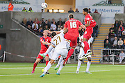 forward Vadaine Oliver gets his header goalwards during the Capital One Cup match between Swansea City and York City at the Liberty Stadium, Swansea, Wales on 25 August 2015. Photo by Simon Davies.
