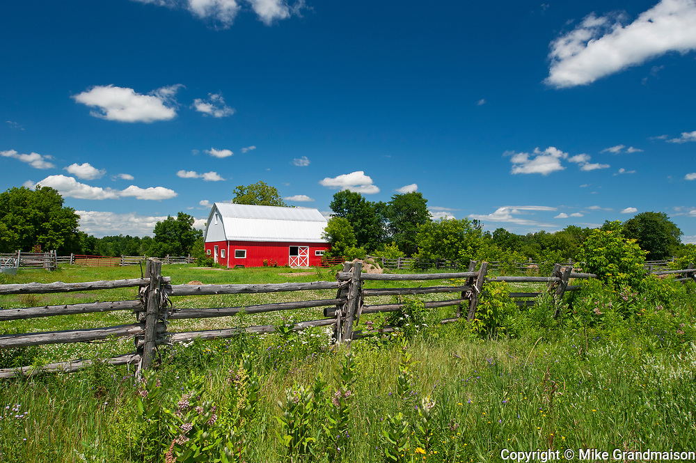 red barn and fence<br />Limoges<br />Ontario<br />Canada