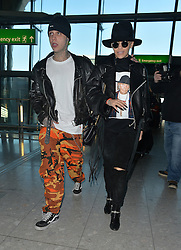 Singer Rita Ora and boyfriend Ricky Hilfiger at Heathrow airport in London, UK. 27/02/2015<br />BYLINE MUST READ : GOTCHAIMAGES.COM<br /><br />Copyright by © Gotcha Images Ltd. All rights reserved.<br />Usage of this image is conditional upon the acceptance <br />of Gotcha Images Ltd, terms and conditions available at<br />www.gotchaimages.com