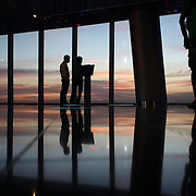 Tourists enjoy the sunset and view of Ho Chi Minh City from the viewing level of The Bitexco Financial Tower in Ho Chi Minh City, Vietnam. 3rd March 2012. Photo Tim Clayton