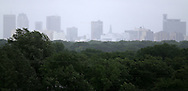 Rain Showers make the downtown skyline hard to see, from Garbage Hill, Sunday, June 29, 2014. (TREVOR HAGAN/WINNIPEG FREE PRESS)