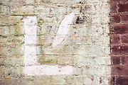 The letter 'L' painted on a deteriorating brick wall. Missoula Photographer