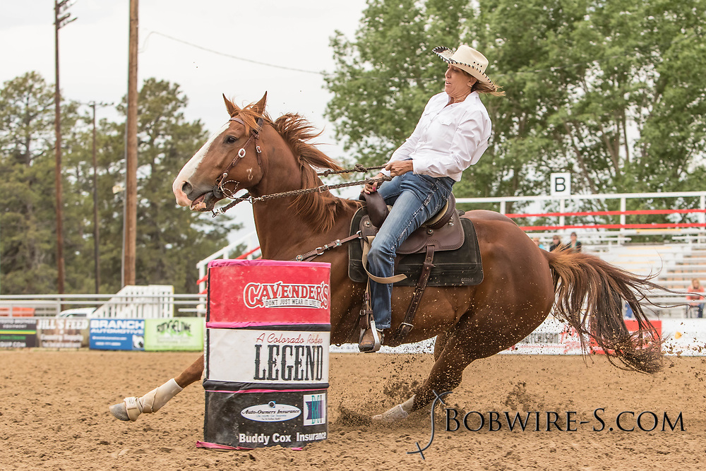 Rebecca Schattinger makes her barrel racing run during slack at the Elizabeth Stampede on Sunday, June 3, 2018.