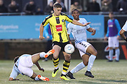 The ball breaks in the box for Harrogate Town forward Jack Muldoon (18) during the Vanarama National League match between FC Halifax Town and Dover Athletic at the Shay, Halifax, United Kingdom on 17 November 2018.