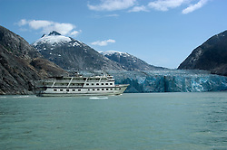 Alaska, Cruising the Southeast wilderness waterways on the Spirit of Discovery.  Endicott Arm and Dawes Glacier, scenery, glacier and cruise ship..Photo #: alaska10580 .Photo copyright Lee Foster, 510/549-2202, lee@fostertravel.com, www.fostertravel.com.