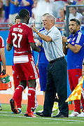 FRISCO, TX - JUNE 26:  Je-Vaughn Watson #27 of FC Dallas celebrates with head coach Schellas Hyndman after scoring a goal against the Portland Timbers on June 26, 2013 at FC Dallas Stadium in Frisco, Texas.  (Photo by Cooper Neill/Getty Images) *** Local Caption *** Je-Vaughn Watson; Schellas Hyndman