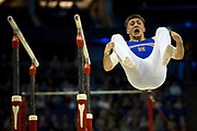 Sam Oldham of Great Britain (GBR) dismounts from the Parallel bars during the iPro Sport World Cup of Gymnastics 2017 at the O2 Arena, London, United Kingdom on 8 April 2017. Photo by Martin Cole.