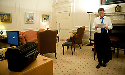 The  Prime Minister David Cameron reads papers in his office inside Number 10 Downing Street on the night he became Britain's new Prime Minister, London, UK, Tuesday May 11, 2010. Photo By Andrew Parsons / i-Images.