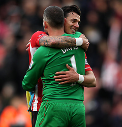 Southampton's Jose Fonte hugs Southampton's Kelvin Davis - Photo mandatory by-line: Robbie Stephenson/JMP - Mobile: 07966 386802 - 21/03/2015 - SPORT - Football - Southampton - ST Marys Stadium - Southampton v Burnley - Barclays Premier League