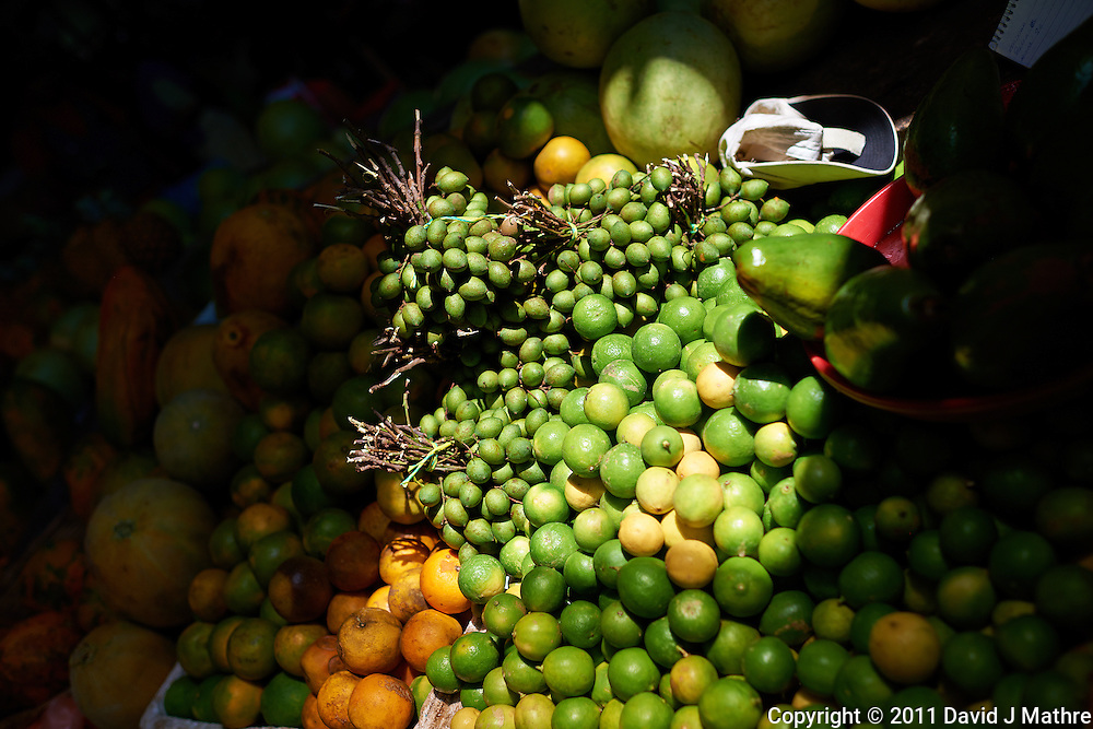Open Air Fruit Market in Leon, Nicaragua. Image taken with a Nikon D3x and 35 mm f/1.4G lens (ISO 100, 35 mm, f/2.8, 1/1250 sec).
