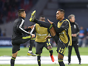 Alex Sandro of Juventus warms up during the Champions League Quarter-Final Leg 1 of 2 match between Ajax and Juventus FC at the Amsterdam Arena, Amsterdam, Netherlands on 10 April 2019.