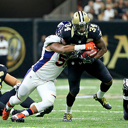Nov 13, 2016; New Orleans, LA, USA;  Denver Broncos inside linebacker Todd Davis (51) tackles New Orleans Saints running back Tim Hightower (34) during the first half of a game at the Mercedes-Benz Superdome. Mandatory Credit: Derick E. Hingle-USA TODAY Sports
