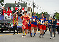Hot dogs, pizza and the Knicks bring a taste of NYC from the Freshman class during Laconia High School's Homecoming parade Friday.  (Karen Bobotas/for the Laconia Daily Sun)