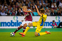 Sofiane Feghouli of West Ham and Gaber Dobrovoljc of NK Domzale during 2nd Leg football match between West Ham United FC and NK Domzale in 3rd Qualifying Round of UEFA Europa league 2016/17 Qualifications, on August 4, 2016 in London, England.  Photo by Ziga Zupan / Sportida