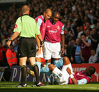 West Ham's Marlon Harewood lies injured after scoring his first goal against Fulham