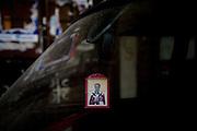 Orthodox icon in car window, Serb section...Scenes from Kosovska Mitrovica, Kosovo, Serbia.
