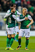 Martin Boyle (#10) of Hibernian and Daryl Horgan (#7) of Hibernian celebrates Hibernian's first goal (1-0), an own goal scored by Genserix Kusunga (#5) of Dundee during the Ladbrokes Scottish Premiership match between Hibernian and Dundee at Easter Road, Edinburgh, Scotland on 24 November 2018.