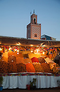 Djemaa El Fna Square in the medina of Marrakesh at dusk. The square is a Unesco World Heritage site.