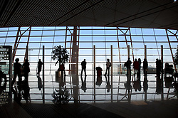 View of windows and passengers inside new Terminal 3 at Beijing International Airport in China